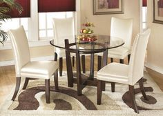 Metro Modern. The straight-line contemporary design of the Marissa dining room collection features a warm finish and the clean look of clear glass to perfectly capture a refreshing and exciting style to enhance your dining room decor. The medium brown finish of the exciting contemporary designed table base beautifully supports a clear glass table top featuring a beveled and polished edge working together flawlessly to create a collection that will add to the atmosphere of any dining…