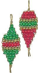 Weave metallic pony beads and translucent beads on gold cord to make stunning ornaments. Easy enough for 2nd grade Girl Scouts.   Kit is available at MakingFriends.com and makes 24 ornamaents