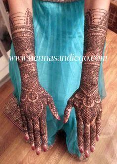 Heavy Bridal Mehendi Design for the back of hands.