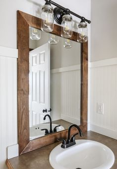 How to Add a DIY Wood Frame to a Bathroom Mirror - Budget Friendly & Frugal Living Ideas - This mirror frame DIY is the perfect start to a bathroom makeover! Wood Framed Bathroom Mirrors, Bathroom Mirror Makeover, Bathroom Mirror Design, Bathroom Mirror Cabinet, Rustic Mirrors, Mirror Cabinets, Modern Bathroom, Bathroom Makeovers, Bathroom Ideas