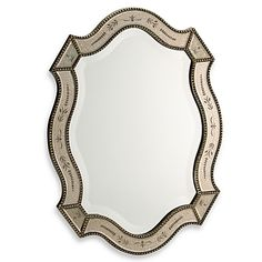 This beveled wall mirror features a gold leaf finish with fine beaded accents. Perfect as a warming wall decoration in any living room or bedroom.