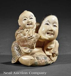 Description: A Japanese Carved Ivory Figural Okimono, Meiji Period (1868-1912), carved as a seated child in a brocade kimono holding a Noh mask, signed, height 3 in