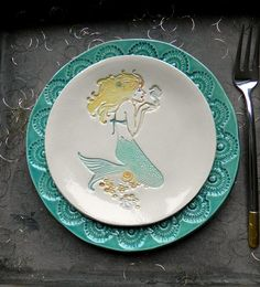 An ocean theme ceramic serving plate set, a mermaid little plate and a turquoise lace dish. Both are hand built and made from white clay. I used turquoise, yellow, blue, ginger under-glaze, a shiny transparent, clear glaze and a special technique to reach this delicate effect. I painted the lace plate with transparent turquoise glaze, it shows beautiful way the pattern. I created a flowery top with a beautiful lace. I used the high quality nontoxic, dinnerware-safe and dish washer-safe glaze…