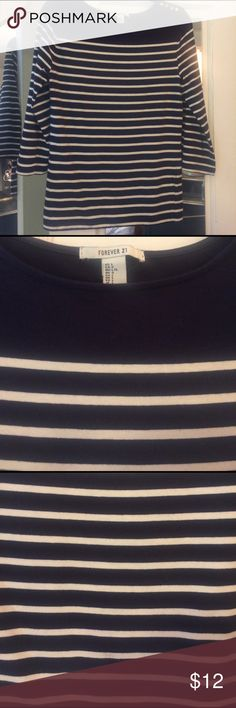 Striped Navy & White Top Size Large. 3/4 sleeves. Gently used worn a few times has gold buttons on one shoulder. Not sure of material I removed the tag but it has spandex as it forms to the body. Armpit armpit 17 inches length 25 inches. Forever 21 Tops