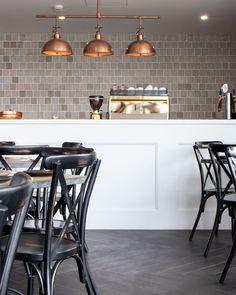 "Skheme Tiles on Instagram: ""Our Vecchio Concrete and Aspen Charcoal is featured in newly built @rickspizzeria . ⠀. design/construct by @aurickau . ⠀ . ⠀…"" Curl Curl, Aspen, Concrete, Charcoal, Tiles, Construction, Furniture, Instagram, Design"