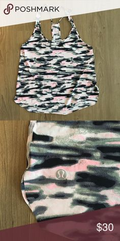 Lululemon Racerback Tank - Pink Camo Great condition - runs tighter than other tanks - fits between 6 & 8 - compression type material - pink Camo and has breathable feel lululemon athletica Tops Tank Tops