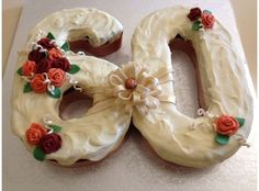 A number cake is a timeless way of celebrating special birthdays or events. Here is a carrot cake with cream cheese frosting to celebrate a 60th birthday for a lady. Roses are in autumn colours and a big loopy bow brings it all together. Celebrate!