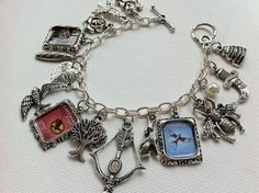 Ok, I can't help it, I normally don't wear specific book-related jewelry...but I LOVE this.
