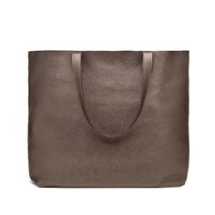 $165 BUY NOW Cuyana's classic tote bag is now available in shimmery bronze. It's crafted from soft Italian leather and can be personalized with gold foil embossing. The color makes a surprising neutral for daily wear. More: Classic Black Leather Tote Bags