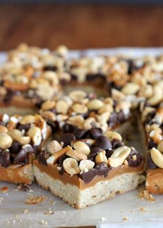 Fully Loaded Bars   Oat shortbread crust, peanut butter caramel, roasted peanuts, pretzels, and semi-sweet chocolate chips! [from bakerita.com]