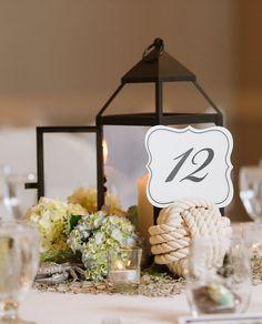 Rustic chic lantern wedding reception centerpiece; Featured Photographer: Natalie Franke Photography