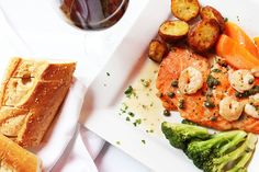 Wild salmon topped with capers and shrimp in a white wine lemon sauce. Served with roasted fingerling potatoes, steamed carrots and broccoli.