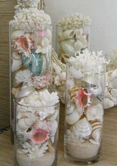 Add teardrop lights and it's gorgeous. Beach Decor - Seashells, Coral and Starfish in Glass Cylinders for our beach bedroom .maybe just one or two here or there. Seashell Crafts, Beach Crafts, Diy Crafts, Coastal Style, Coastal Decor, Coastal Living, Coastal Cottage, Coastal Interior, Lake Cottage