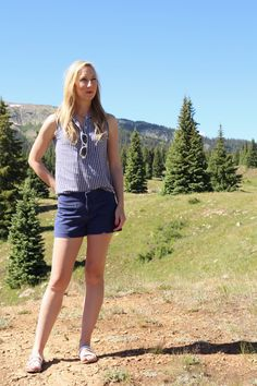 Casual Summer Outfit | J Crew chino shorts, gingham sleeveless shirt, Target white sandals and sunglasses for a casual preppy outfit |  See more of the outfit here: http://www.amodernmomblog.com/2016/08/durango-colorado-mountains/