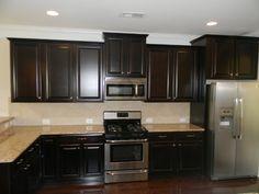 Scottsdale Maple Square Espresso Cabinets.  New Venetian Gold Granite Countertops.  Board #10 backsplash.