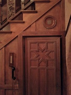 entrance to a wine cellar under the stairs