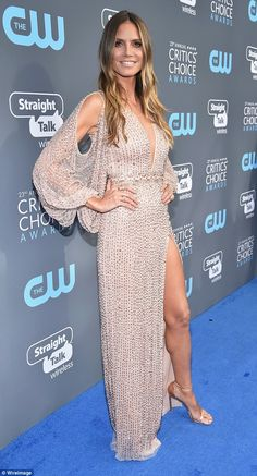 Heidi Klum puts on leggy show in nude embellished dress | Daily Mail Online