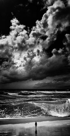black and white photography beach ocean clouds waves person Amazing Photography, Art Photography, Loneliness Photography, Cool Photos, Beautiful Pictures, Scary Photos, Jolie Photo, Black And White Pictures, Black And White Photography