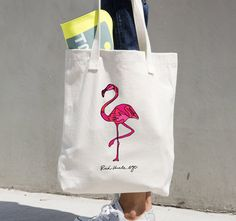 Keeping it classy, with this fabulous flamingo tote. Drawn in a single line, this sketch inspired by the lawn ornament, is sure to step up the color and fabulous factor of any outfit.  100% Bull Denim Woven Cotton