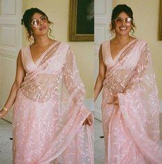 Priyanka Chopra Jonas looks lovely in a rose pink saree and rose tinted sunnies 😍 . Priyanka Chopra Saree, Priyanka Chopra Wedding, Sabyasachi Sarees, Indian Sarees, Indian Wedding Outfits, Indian Outfits, Indian Clothes, Saree Poses, Saree Hairstyles