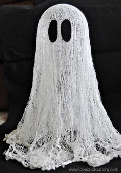 Floating Cheesecloth Ghost by www.loveandlaundry.com                         Make a ghost family, put little ribbon bows on heads of mom and girl