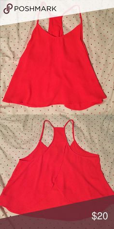 Fun Open-Back Top vibrantly red top perfect to complete the ultimate summer look. no size listed on shirt but most likely fits a medium boutique Tops