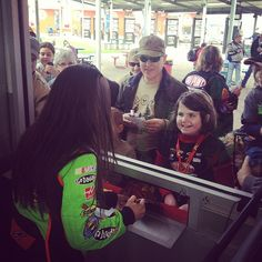 Photo by stewarthaasracing  Going out on a limb to say the young lady in the photo was pretty excited to get danicapatrick's autograph