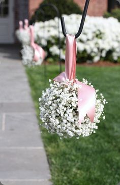 babys-breath-pomander to line the aisle we walk down.  Except with a green ribbon.  I like this.  And we can always use fake flowers