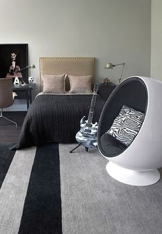 Sophisticated teen boy's bedroom in grey, tan and black with Aarnio ball chair. Teen Boy hideaway Kate Hume | Manor england