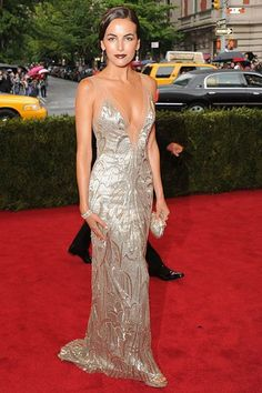 Camilla Belle    Camilla Belle channels old Hollywood glamour in a silver, body-hugging, floor-length dress by Ralph Lauren.