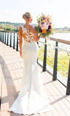Stunning Essense of Australia used wedding gown with amazing statement back for sale at 35% off. #softfemininebridalinspiration #EssenceofAustraliaBridal #designerweddingdresses #usedweddingdresses #preownedweddingdresses