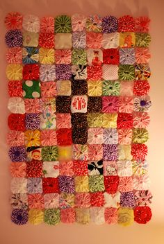 Yoyo quilt, made from Old Baby clothes that are too sentimental to give away. I think I might do this!