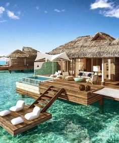 Floating hotel bungalow over the water in beautiful tropical destination.