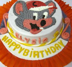 He wants a cake with chuck e cheese on it...