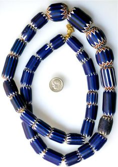 #CHE-164 Long strand of 36 mixed 4 and 6-layer Venetian chevrons Length of strand: 32 inches;nSize 14 x 13mm to 30 x 23mm Date: Mid 1800s - early 1900s - Price: $650.00