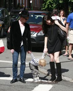 Liv Tyler and Spacehog's Royston Langdon hold their son Milo's hand.