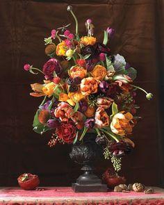 beautiful arrangement. great fall/ winter colors. Love the tangerine orange color.