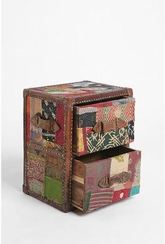 Awesome Patchwork Side table from Urban Outfitters.  $169.99           Maybe someday...
