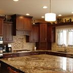 Delicatus Gold granite countertop with travertine back splashes - Traditional - Kitchen - philadelphia - by Virtual Warehouse