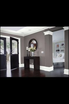 Hard wood floor color with white molding and nuetral walls