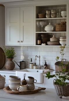 Farmhouse kitchen with white cabinets and open shelving. Farmhouse sink and larg. Farmhouse kitchen with white cabinets and open shelving. Farmhouse sink and large subway tile, lots of Farmhouse Decor i. White Kitchen Cabinets, Kitchen Shelves, Kitchen Walls, Kitchen Countertops, Soapstone Kitchen, White Cupboards, Open Cabinets, Kitchen Sink, Cottage Kitchens