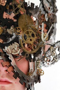 this represents the gears and is on his head, could be to show that the mind works like a clock