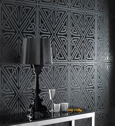 An edgy and bold geometric design, this wallpaper is sure to impress. The design features a large scale symmetrical motif in gloss black on black. http://www.wowwallpaperhanging.com.au/black-wallpaper/