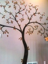 Family Tree painted wall mural as a backdrop for framed family photos!