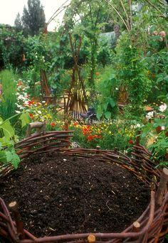 Compost Heap in Pretty Garden Setting | Plant & Flower Stock Photography: GardenPhotos.com