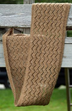 Mead scarf. I've noticed a few folks mention problems with it curling. The seed stitch border can only do so much to prevent this. The yarn for the sample was a two-ply hand-spun alpaca, which has very little resiliency. A tightly-spun sock yarn will tend to behave differently.