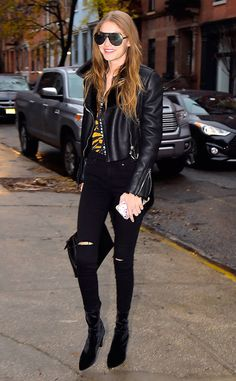 Edgy from Gigi Hadid's Street Style  Gigi is all smiles rocking ripped jeans and a black leather jacket in New York City.