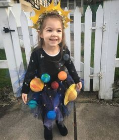 25 Ridiculously Easy and Fun DIY Halloween Costumes for Everyone Solar system Halloween costume with light up skirt and planets. The post 25 Ridiculously Easy and Fun DIY Halloween Costumes for Everyone appeared first on Halloween Kids. Meme Costume, Costume Contest, Costume Ideas, Costumes Faciles, Diy Halloween Costumes For Kids, Funny Halloween, Costume For Kids, Halloween Party, Haloween Costume Diy