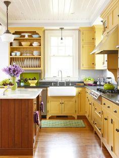 yellow kitchen cabinets. So bright! very pretty cottage kitchen.