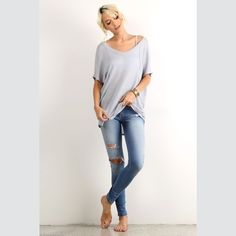Short Sleeve V Neck Tunic Short sleeve v-neck tunic with high low hem. Loose fitting and so soft. Fabric has a waffle texture. Material is 65% polyester and 35% rayon. Vega Boutique Tops